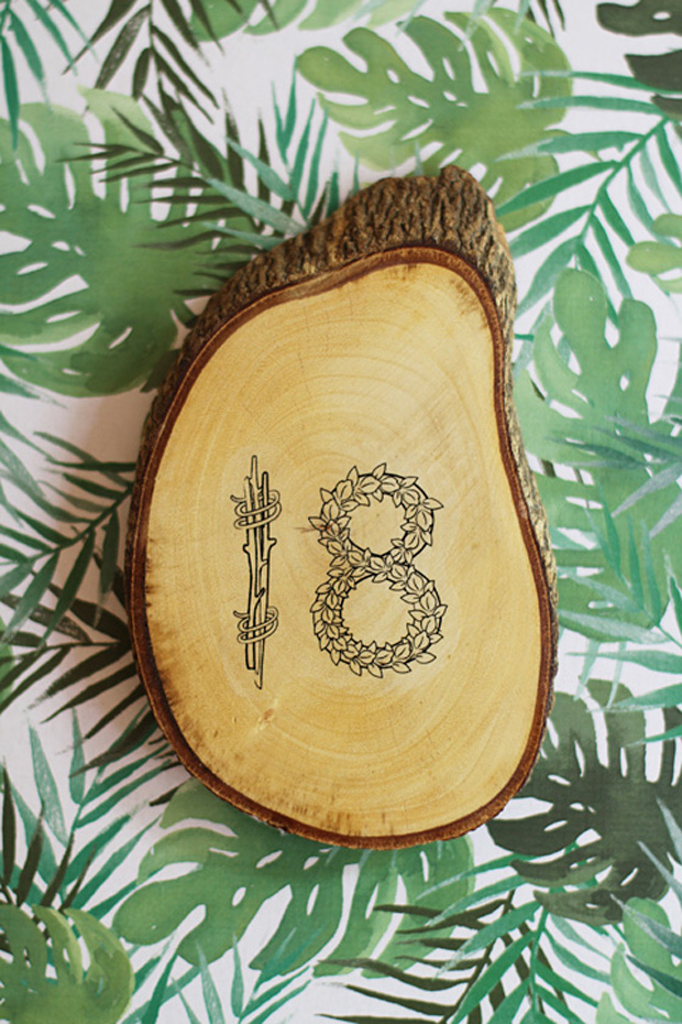 To get the howto for this fab DIY rustic wedding table numbers