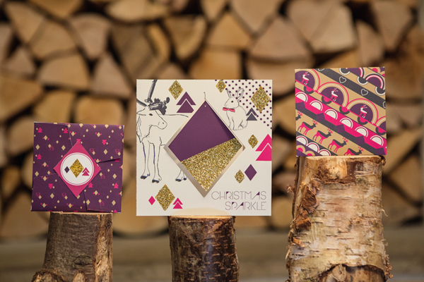 diamond design purple and gold card with line drawn reindeer and rabbit